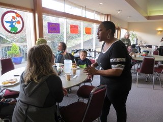 people around tables at Nehalem Bay UMC