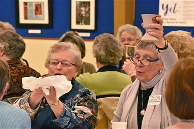 women hold communion elements in Portland